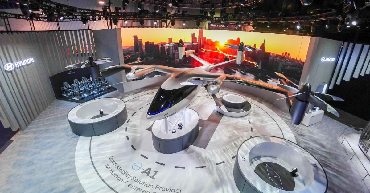 Hyundai S-A1 airtaxi at trade show aerial view.